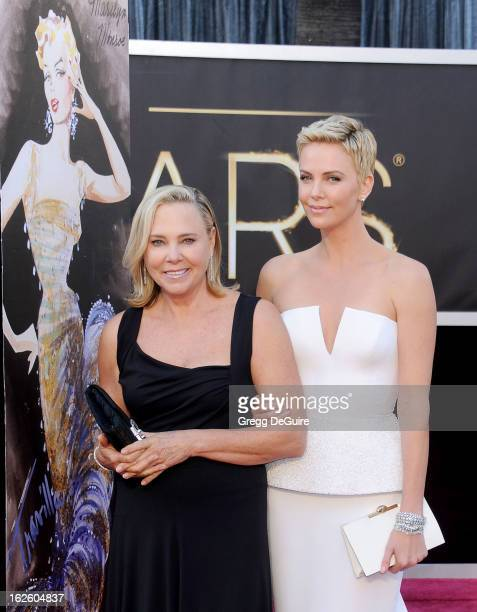 Actress Charlize Theron and mom Gerda Jacoba Aletta Maritz arrive at the Oscars at Hollywood Highland Center on February 24 2013 in Hollywood...