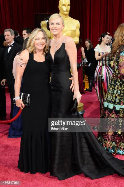 Actress Charlize Theron and mother Gerda Jacoba Aletta Maritz attend the Oscars held at Hollywood Highland Center on March 2 2014 in Hollywood...