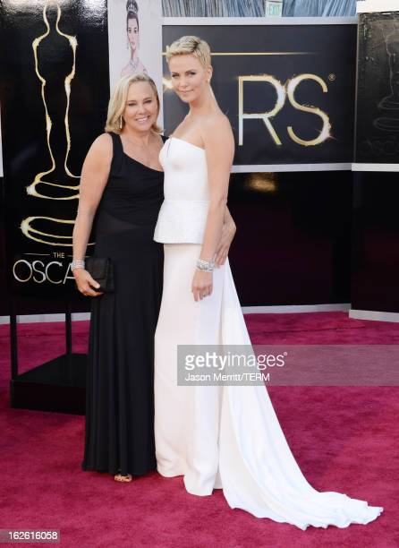 Actress Charlize Theron and mother Gerda Maritz arrive at the Oscars at Hollywood Highland Center on February 24 2013 in Hollywood California