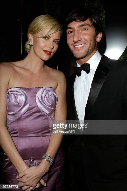 WEST HOLLYWOOD CA MARCH 07 *EXCLUSIVE* Actress Charlize Theron and Olympic Gold Medalist Evan Lysacek attend the 2010 Vanity Fair Oscar Party hosted...
