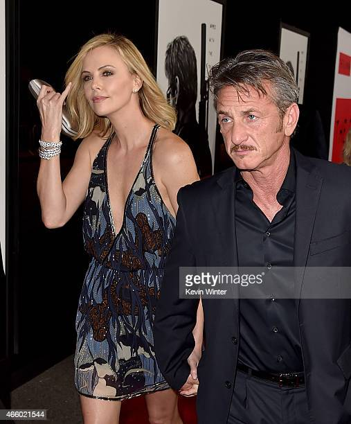 Actress Charlize Theron and producer/actor Sean Penn attend the premiere of Open Road Films' The Gunman at Regal Cinemas LA Live on March 12 2015 in...