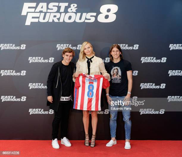 Actress Charlize Theron and soccer players Antoine Griezmann and Filipe Luis attend the 'Fast Furious 8' photocall at Villamagna hotel on April 6...