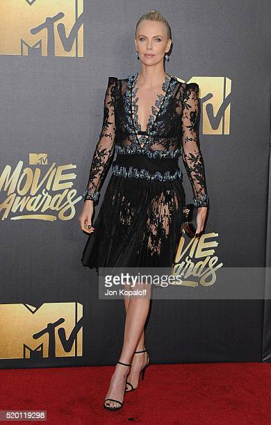 Actress Charlize Theron arrives at the 2016 MTV Movie Awards at Warner Bros Studios on April 9 2016 in Burbank California