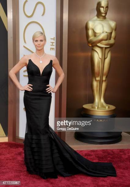 Actress Charlize Theron arrives at the 86th Annual Academy Awards at Hollywood Highland Center on March 2 2014 in Hollywood California