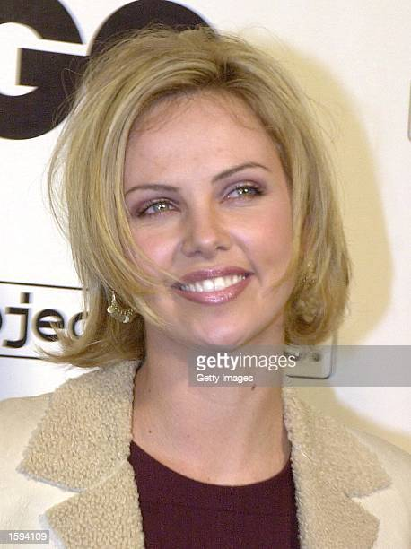 Actress Charlize Theron arrives at the GQ Magazine Second Annual Hollywood Issue party February 15 2001 in West Hollywood CA