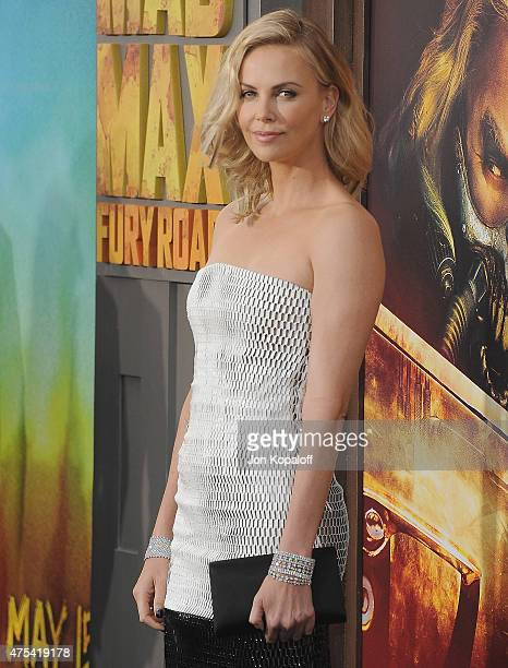 "Actress Charlize Theron arrives at the Los Angeles Premiere ""Mad Max: Fury Road"" at TCL Chinese Theatre IMAX on May 7, 2015 in Hollywood, California."