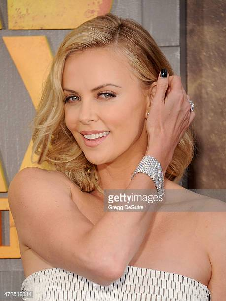 """Actress Charlize Theron arrives at the Los Angeles premiere of """"Mad Max: Fury Road"""" at TCL Chinese Theatre IMAX on May 7, 2015 in Hollywood,..."""