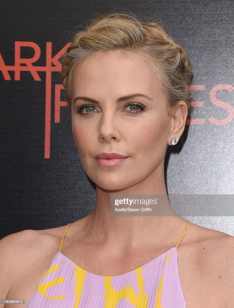 Actress Charlize Theron arrives at the premiere of DIRECTV's 'Dark Places' at Harmony Gold Theatre on July 21, 2015 in Los Angeles, California.