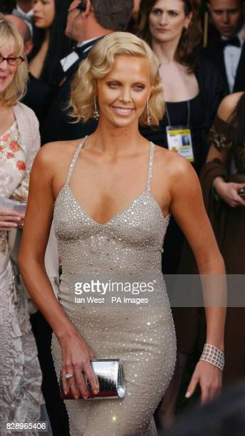 Actress Charlize Theron arrives at the The 76th Annual Academy Awards at the Kodak Theatre in Los Angeles USA Charlize was wearing a dress by Tom...