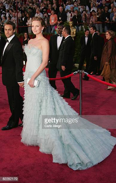 Actress Charlize Theron arrives with her husband Stuart Townsend arrive at the 77th Annual Academy Awards at the Kodak Theater on February 27 2005 in...