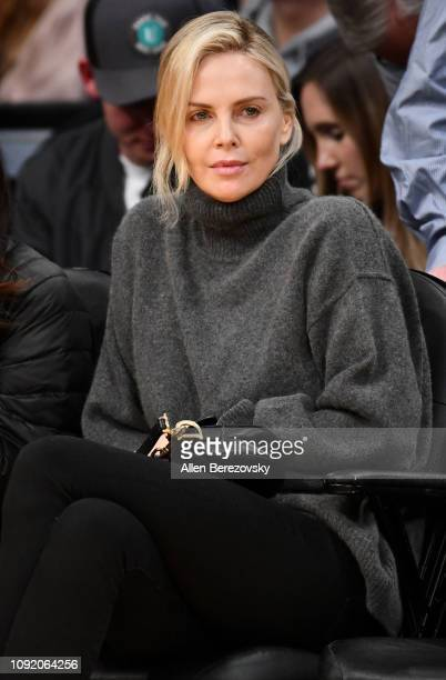 Actress Charlize Theron attends a basketball game between the Los Angeles Lakers and the Detroit Pistons at Staples Center on January 09 2019 in Los...