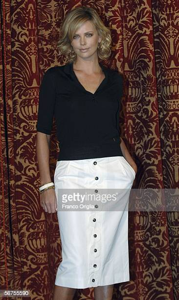 """Actress Charlize Theron attends a photocall for her new film """"North Country"""" at the Hotel St. Regis on February 6, 2006 in Rome, Italy."""