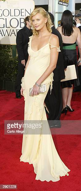 Actress Charlize Theron attends the 61st Annual Golden Globe Awards at the Beverly Hilton Hotel on January 25 2004 in Beverly Hills California