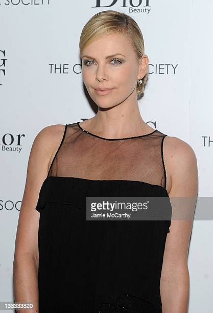 Actress Charlize Theron attends the Cinema Society Dior Beauty screening of Young Adult at the Tribeca Grand Screening Room on November 18 2011 in...