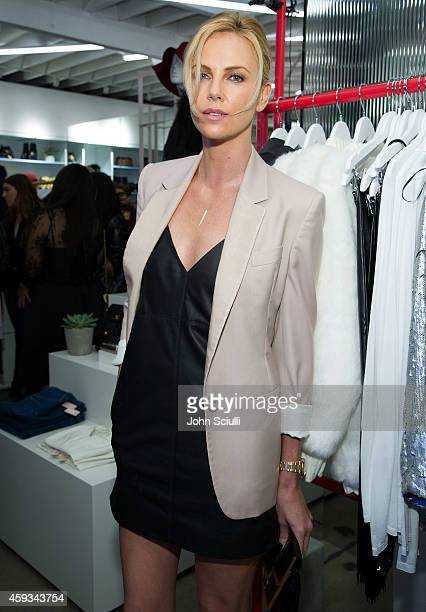 Actress Charlize Theron attends the Nasty Gal Melrose Store Launch on November 20 2014 in Los Angeles California