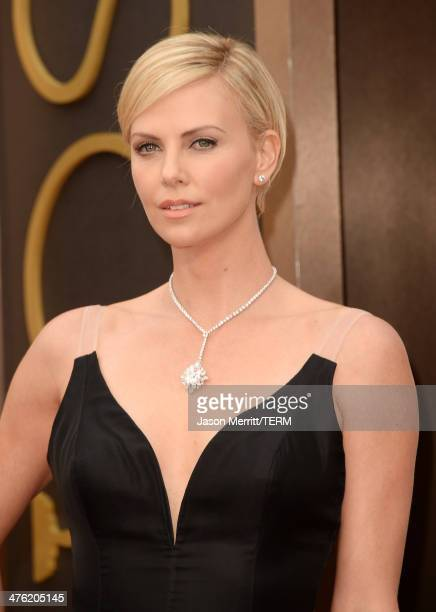 Actress Charlize Theron attends the Oscars held at Hollywood Highland Center on March 2 2014 in Hollywood California