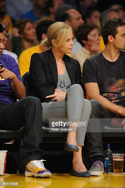 Actress Charlize Theron attends the season opener between the Los Angeles Clippers and the Los Angeles Lakers at Staples Center on October 27 2009 in...
