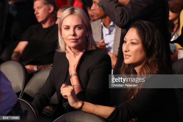 Actress Charlize Theron attends the super welterweight boxing match between Floyd Mayweather Jr and Conor McGregor on August 26 2017 at TMobile Arena...