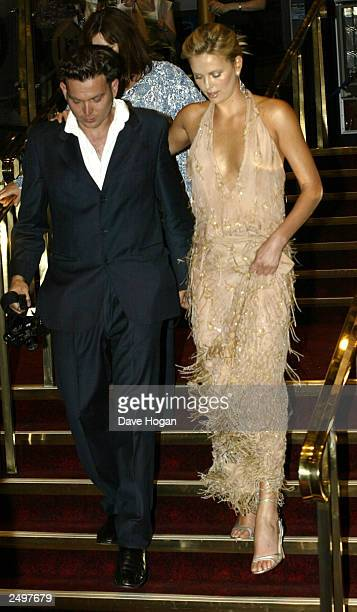 """Actress Charlize Theron attends the UK charity premiere of """"The Italian Job"""" at the Empire Leicester Square September 15, 2003 in London, England."""