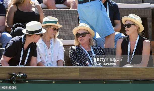 Actress Charlize Theron her mother Gerda Jacoba Aletta Maritz producer Megan Ellison and director Drew Denny attend the women's mens finals during...