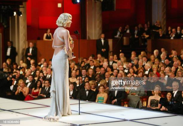 Actress Charlize Theron is photographed on stage after winning the Oscar for her performance in 'Monster' at the 76th Annual Academy Awards for Los...