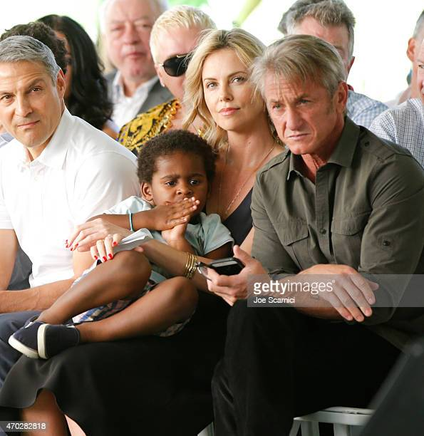 Actress Charlize Theron Jackson Theron and actor Sean Penn attend the Points of Light generationOn Block Party on April 18 2015 in Los Angeles...