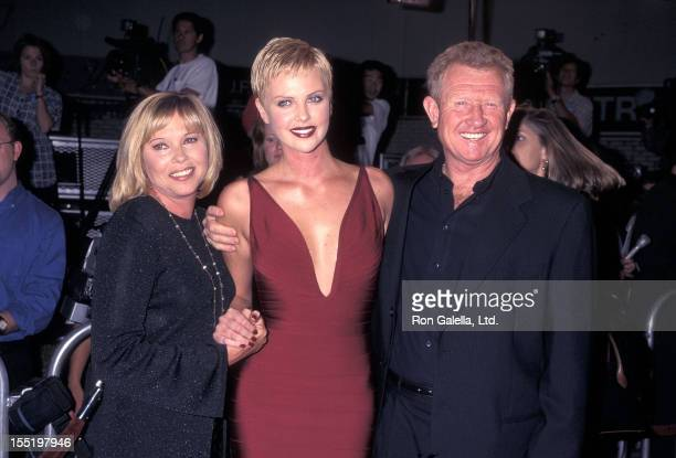 Actress Charlize Theron mother Gerda Theron and stepfather attend The Devil's Advocate Westwood Premiere on October 13 1997 at Mann Village Theatre...