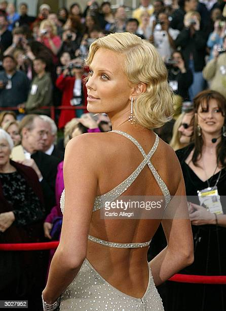 """Actress Charlize Theron, nominated for Best Actress for her performance in """"Monster"""" attends the 76th Annual Academy Awards at the Kodak Theater on..."""