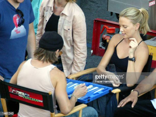 Actress Charlize Theron plays backgammon during a break on the set of the Italian Job on October 5 2002 in Hollywood California