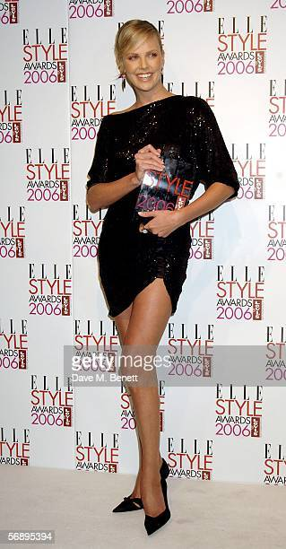 Actress Charlize Theron poses backstage in the Awards Room with the Woman of the Year Award at the ELLE Style Awards 2006 the fashion magazine's...