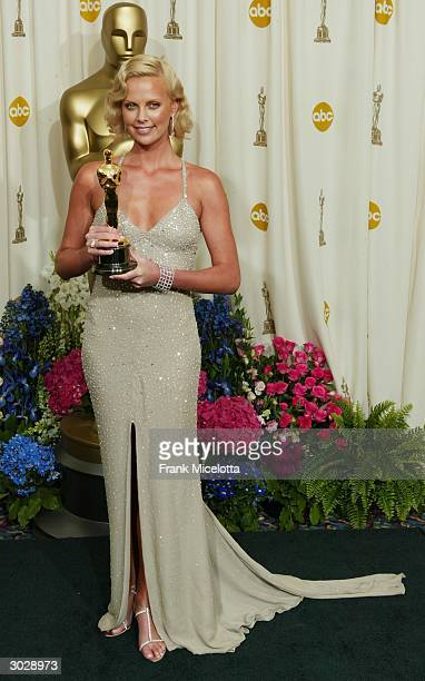 """Actress Charlize Theron poses backstage with her Oscar after winning Best Female Actress for """"Monster"""" during the 76th Annual Academy Awards at the..."""