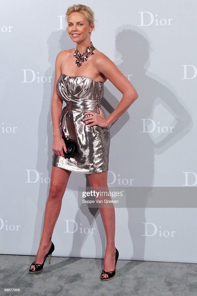 Actress Charlize Theron poses for a photograph at the entrance of the Dior Cruise 2011 fashion show on May 15, 2010 in Shanghai, China.