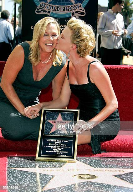 Actress Charlize Theron poses with her mother Gerda after receiving her star on the Hollywood Walk of Fame on Hollywood Blvd on September 29 2005 in...