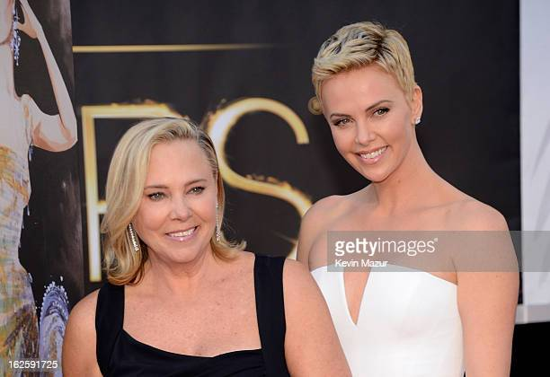 Actress Charlize Theron poses with her mother Gerda Maritz at the Oscars at Hollywood Highland Center on February 24 2013 in Hollywood California