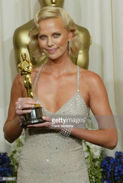 Actress Charlize Theron poses with her Oscar for Best Actress during the 76th Annual Academy Awards at the Kodak Theater on February 29, 2004 in...