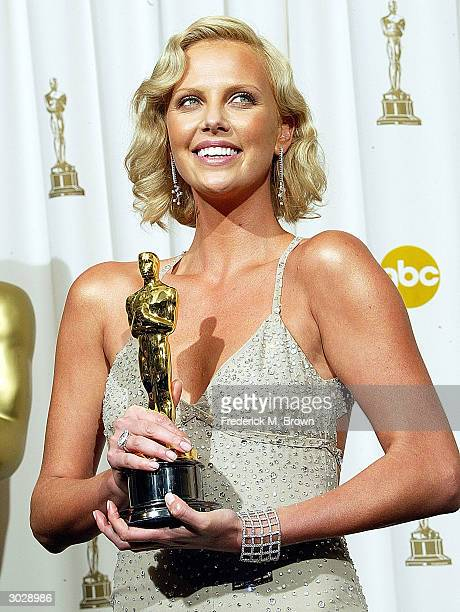 Actress Charlize Theron poses with her Oscar for Best Actress during the 76th Annual Academy Awards at the Kodak Theater on February 29 2004 in...