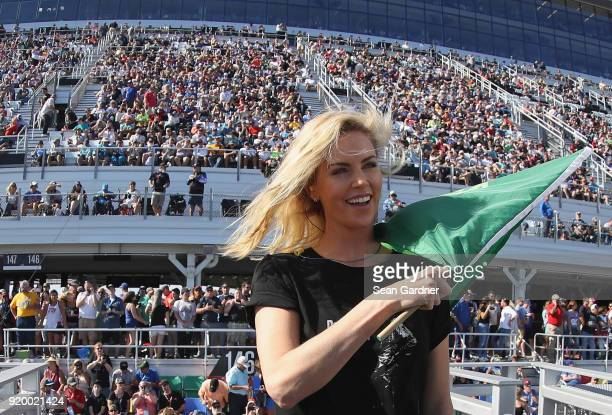 Actress Charlize Theron prepares to wave the green flag to start the Monster Energy NASCAR Cup Series 60th Annual Daytona 500 at Daytona...