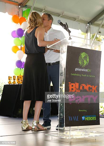 Actress Charlize Theron presents coCEO of William Morris Endeavor Ari Emanuel with the Make Your Mark Award at the Points of Light generationOn Block...