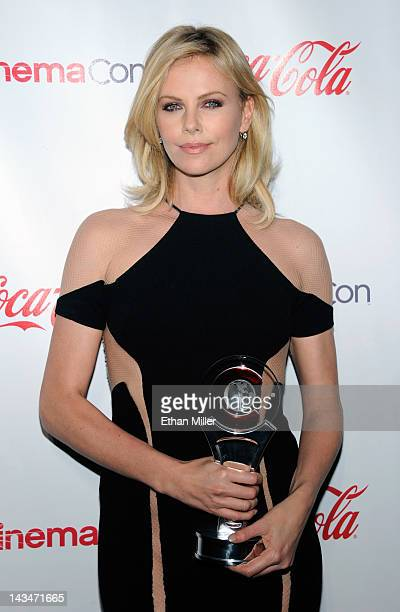 Actress Charlize Theron recipient of the Distinguished Decade of Achievement in Film Award arrives at the CinemaCon awards ceremony at the Pure...