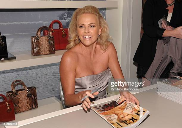 Actress Charlize Theron signs autographs at the Dior celebration of Fashion's Night Out at Dior Boutique on September 10 2009 in New York City