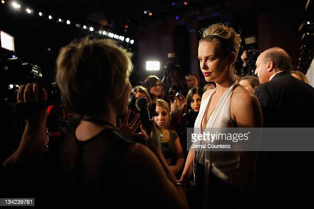 Actress Charlize Theron speaks to media at the IFP's 21st Annual Gotham Independent Film Awards at Cipriani Wall Street on November 28, 2011 in New...