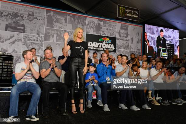 Actress Charlize Theron waves to the crowd during the drivers meeting for the Monster Energy NASCAR Cup Series 60th Annual Daytona 500 at Daytona...