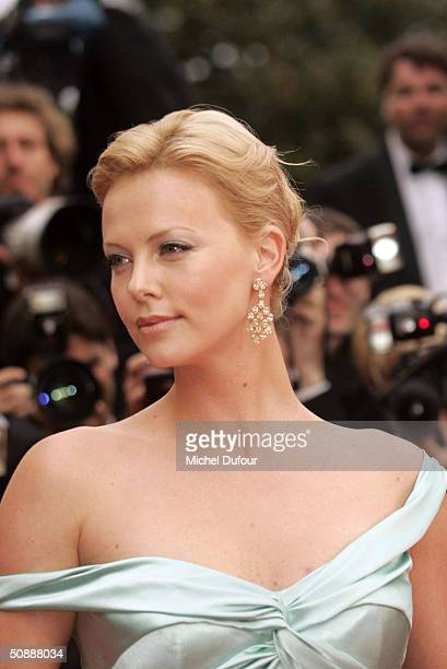 Actress Charlize Theron wearing Chopard jewelry arrives to the closing night ceremony and the screening of DeLovely during the 57th Cannes Film...