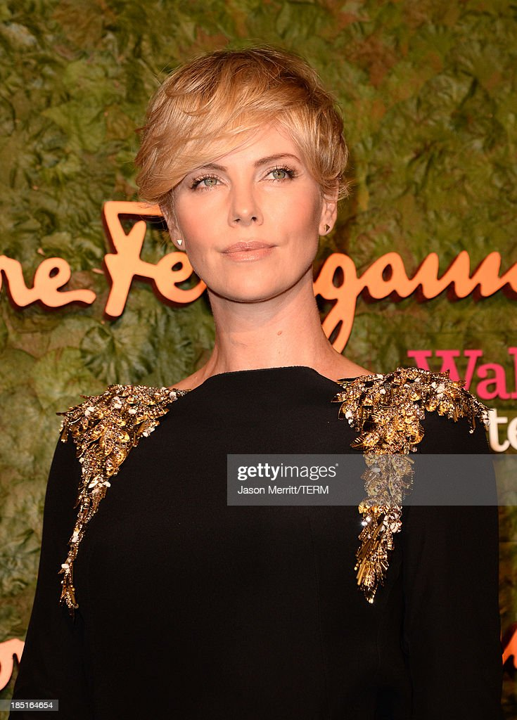 Actress Charlize Theron, wearing Ferragamo, arrives at the Wallis Annenberg Center for the Performing Arts Inaugural Gala presented by Salvatore Ferragamo at the Wallis Annenberg Center for the Performing Arts on October 17, 2013 in Beverly Hills, California.