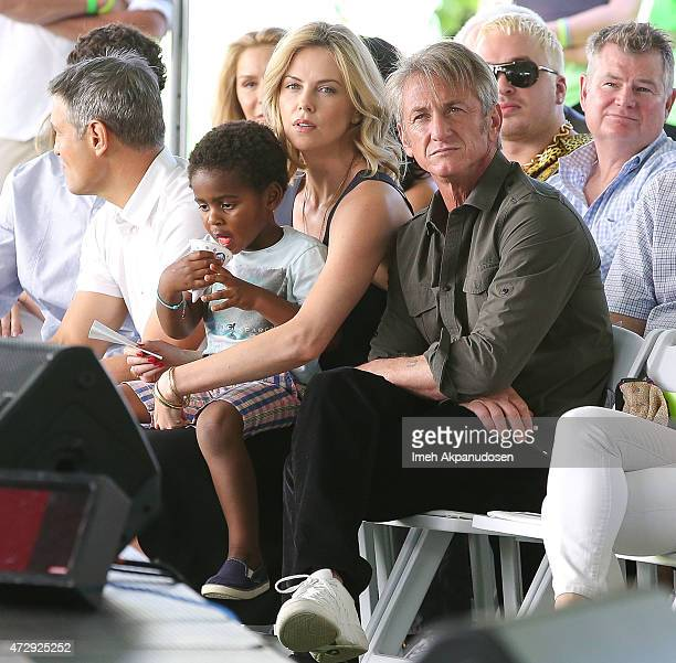 Actress Charlize Theron with her son Jackson Theron and actor Sean Penn attend the generationOn west coast block party at Fox Studio Lot on April 18...