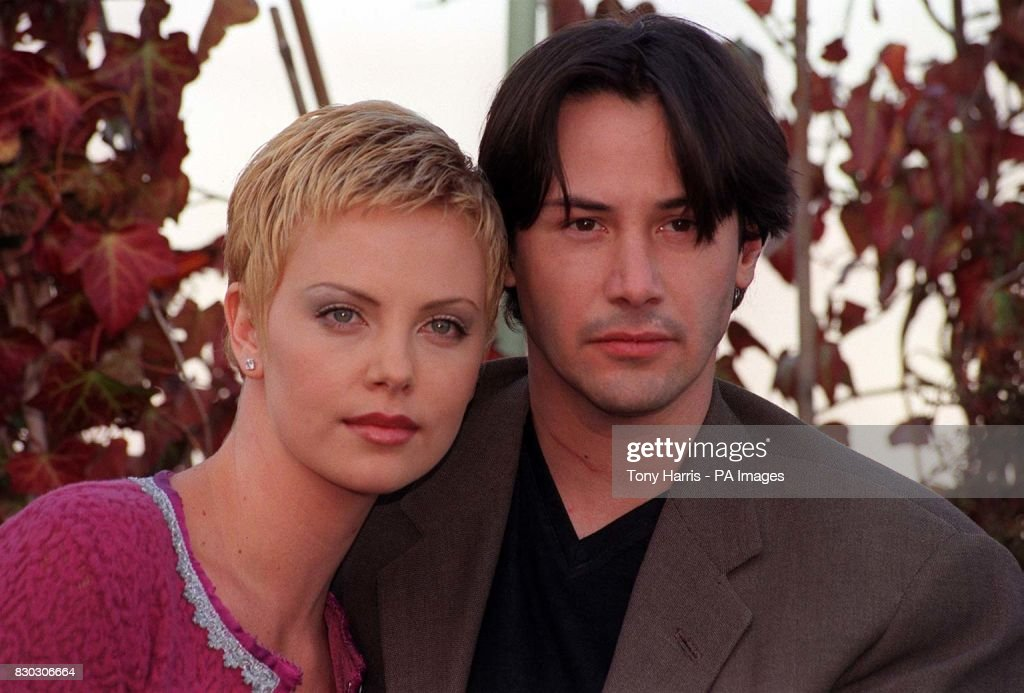 Actress Charlize Theron with Keanu Reeves at a photocall ...