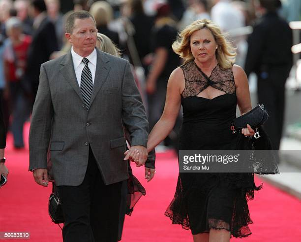 Actress Charlize Theron's Mother Gerda arrives with an unidentified man at the Auckland premiere of 'North Country' on January 27 2006 in Auckland...