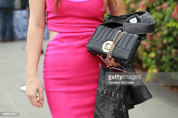 Actress Charlotte Best wearing Ginger and Smart boots Bec and Bridge dress and jacket miu miu glasses and Kate Spade bag at MercedesBenz Fashion Week...
