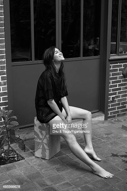109160008 Actress Charlotte Gainsbourg is photographed for Madame Figaro on April 5 2014 in Paris France Tshirt and bra panties Makeup by Dior...