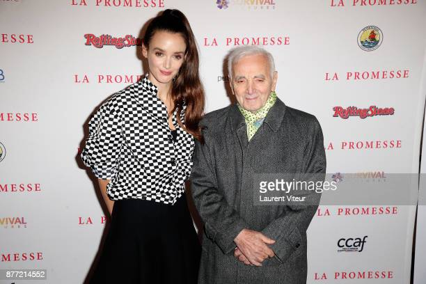 Actress Charlotte Le Bon and Actor and Singer Charles Aznavour attend 'The Promise' Paris Premiere at Publicis Champs Elysees on November 21 2017 in...